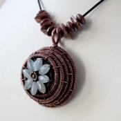 Woven flower pendant