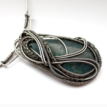 Fossilised silver wrapped pendant portfolio
